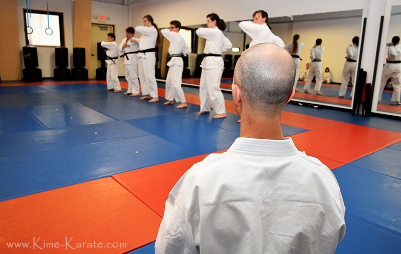 Sensei Keyes watching students during their black belt promotion.